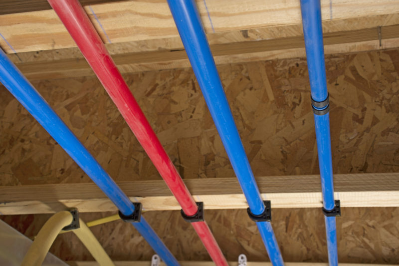 pex pipes attached to the basement ceiling during a project in Concord, California