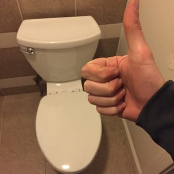 Toilet with clogged drains cleared by plumbing solutions