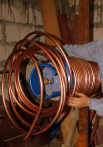 spool of copper piping for whole home repipe starting in basement