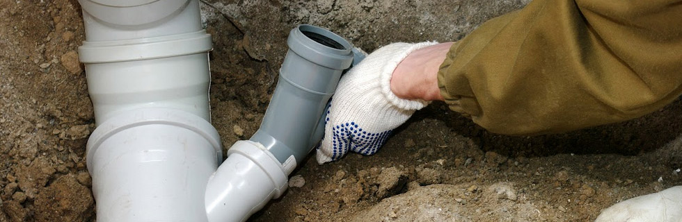 what causes a collapsed sewer line?