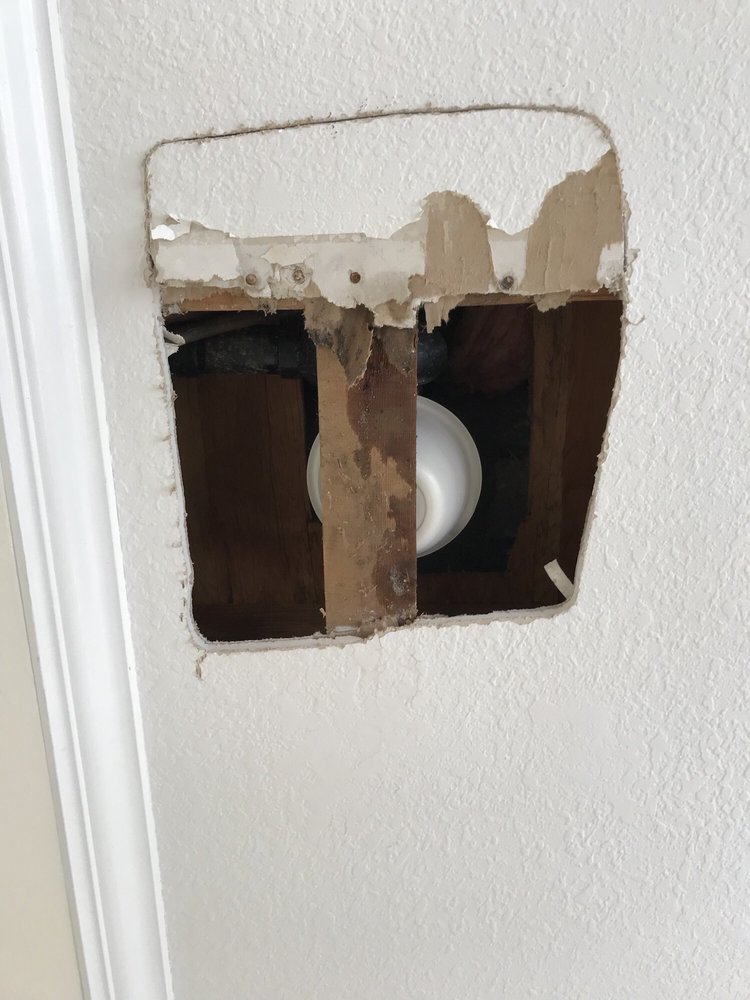 pipe inside wall near living room leaking water because of corrosion. Hole had to be cut in wall